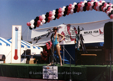 P024.214m.r.t  Judith McConnell on stage in a nude suit and revealing blue bathing suit