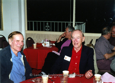 "P040.121m.r.t SAGE General Meeting; 2 men sitting at a table (from left to right: unknown and Richard ""Dick"" Magruder),"
