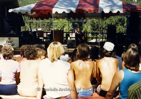 P024.222m.r.t  Woman speaking in to microphone on Day stage while audience looks on
