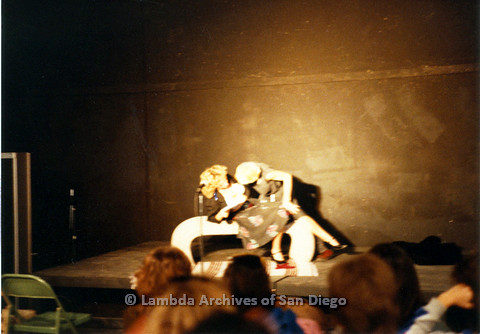 P024.200m.r.t Ellie Rapp (left) and Laura Sutherland bending over her on stage