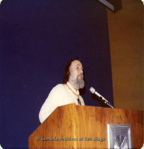 P110.041m.r.t Metropolitan Community Church: Joseph Gilbert standing behind podium.