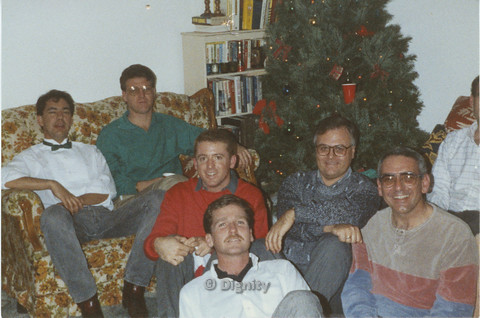 P104.090m.r.t Dignity San Diego: Men sitting in front of a Christmas tree