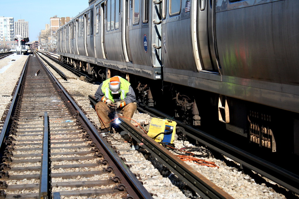 Third Rail Replacement A Welder Secures Jumper Cables To