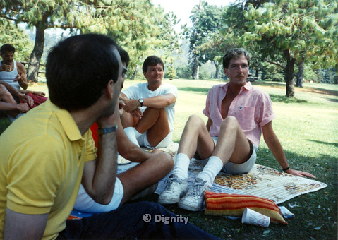 P104.049m.r.t Dignity Picnic 4th of July: Men sitting in the shade at the park