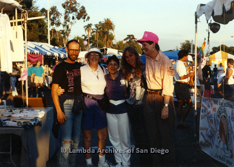 P024.526m.r.t 1990 San Diego Pride festival: (Left to right) unknown man, Deanna Gauthier, two unknown women, and Judith McConnell taking a picture