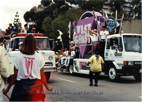 P024.452m.r.t 1990 San Diego Pride parade: Club West Coast pride float next to unknown float
