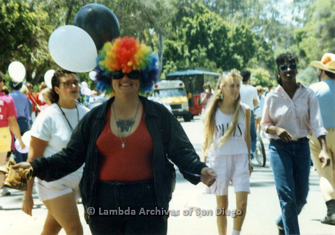 P024.500m.r.t 1990 San Diego Pride: A smiling Leslie Menitti in a clown wig