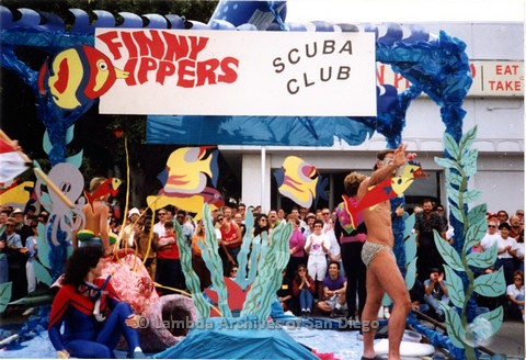 San Diego LGBT Pride Parade, July 1991, Finny Dippers Scuba Club contingent. In the background is the Original Chicken Pie Shop at 5th and Robinson in Hillcrest, San Diego.