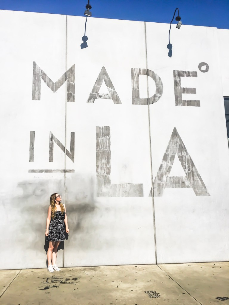 A picture in front of the made in LA wall at Melrose Avenue Walls