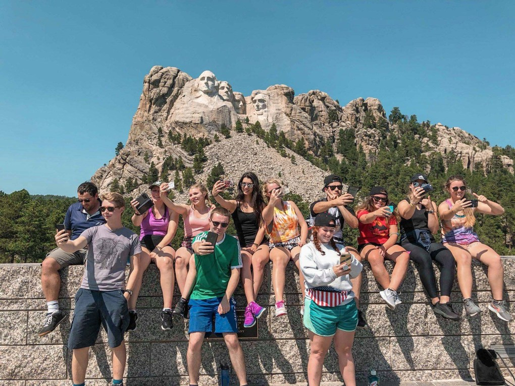 Things to bring on a road trip: Taking a Selfie at Mount Rushmore
