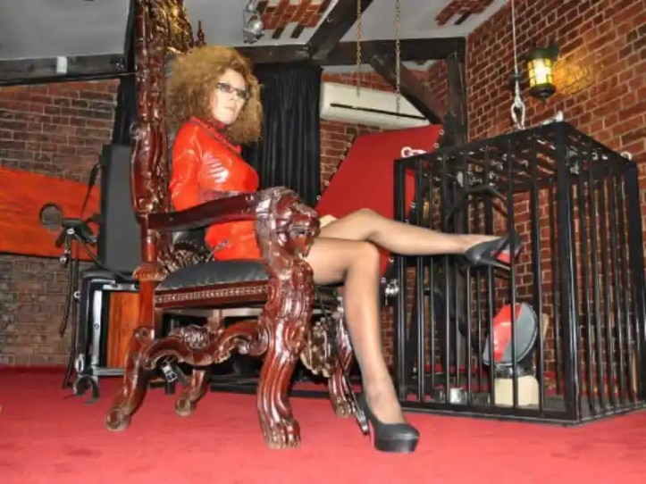 mistress with slave in cage