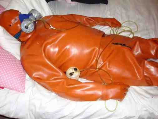slave in rubber suit, bdsm slave in gas mask, bdsm pictures