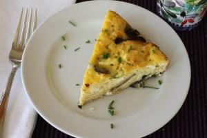 Asparagus Mushroom Frittata slice on plate
