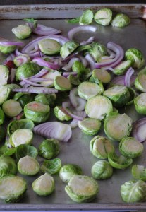 sheet pan with Brussels sprouts and red onion
