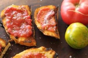 Grilled Tomato Bread | My favorite souvenir from New Jersey! Chewy warm garlic toast with smashed fresh tomato and salt. Yep! www.LiveBest.info