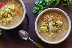 2 Corn Jalapeno Soup bowls with spoon