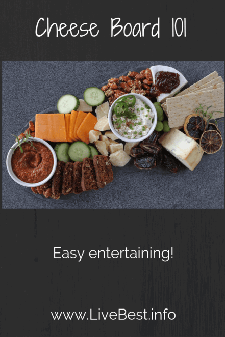 image of cheese board with dips, crackers, vegetables and dried fruit