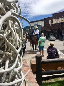 Jackson Wyoming town square sheriff on horseback