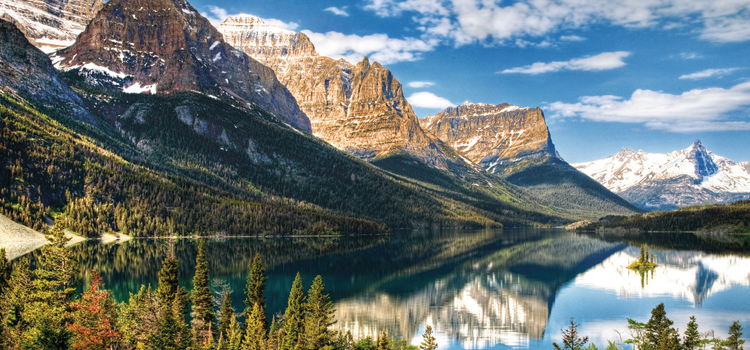 three awesome camping destinations in the united states, glacier national park, picture of a mountain range and lake at glacier national park