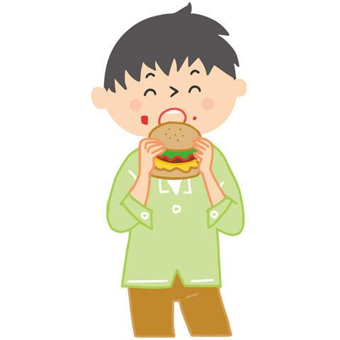 ハンバーガーを食べる男性