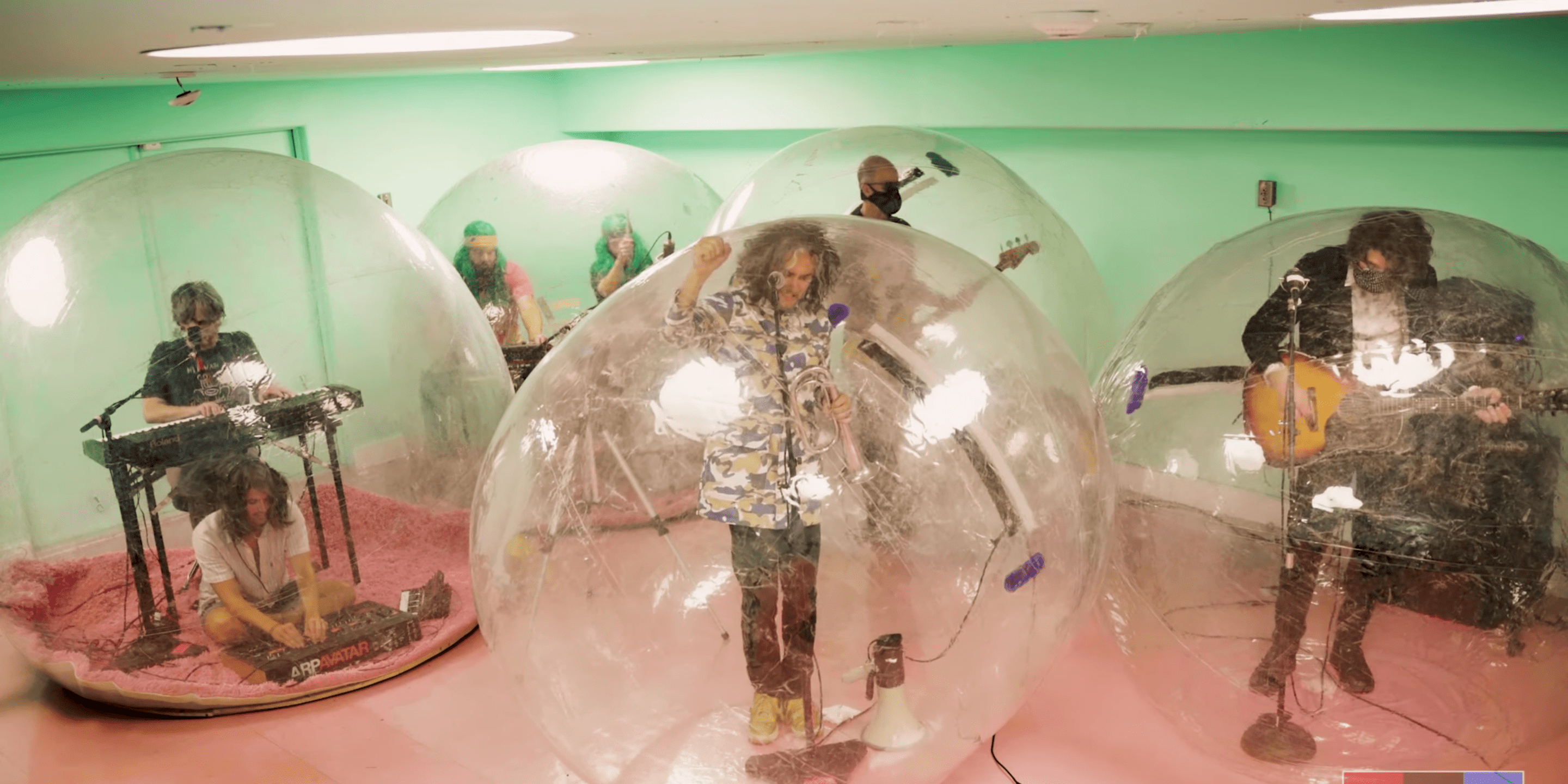 The Flaming Lips Perform Socially-Distanced 'Tiny Desk (Home) Concert' From  Plastic Bubbles [Watch]