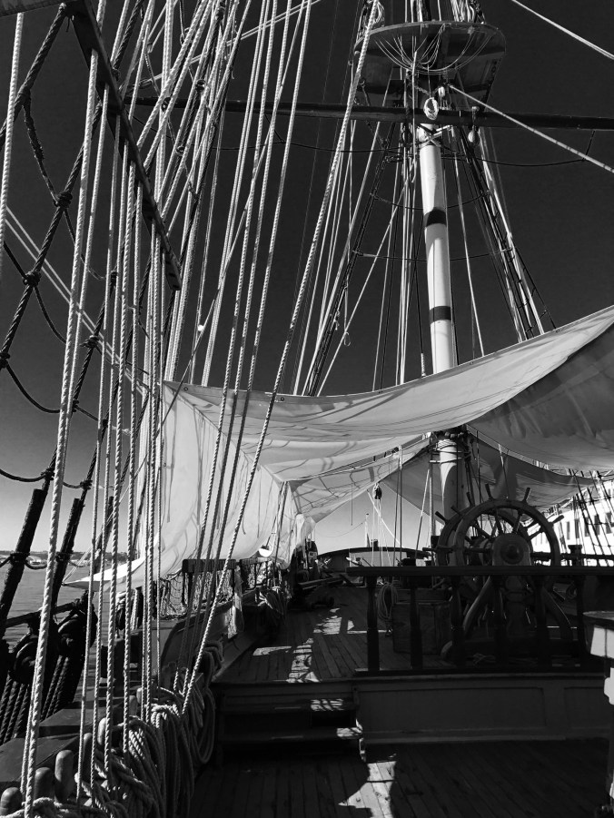Looking aft on the Surprise, tarps to keep all the rain off her teak decks