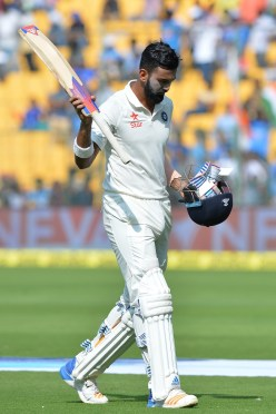 India's Lokesh Rahul raises his bat to acknowledge the crowds applause as he walks back to the pavilion after being dismissed for 90 runs during the first day of the second cricket Test match between India and Australia at The M. Chinnaswamy Stadium in Bangalore on March 4, 2017. ----IMAGE RESTRICTED TO EDITORIAL USE - STRICTLY NO COMMERCIAL USE----- / GETTYOUT / AFP PHOTO / Manjunath KIRAN / ----IMAGE RESTRICTED TO EDITORIAL USE - STRICTLY NO COMMERCIAL USE----- / GETTYOUT