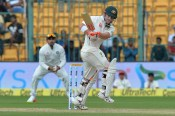 Australian batsman David Warner plays a shot during the first day of the second cricket Test match between India and Australia at The M. Chinnaswamy Stadium in Bangalore on March 4, 2017. ----IMAGE RESTRICTED TO EDITORIAL USE - STRICTLY NO COMMERCIAL USE----- / GETTYOUT / AFP PHOTO / Manjunath KIRAN / ----IMAGE RESTRICTED TO EDITORIAL USE - STRICTLY NO COMMERCIAL USE----- / GETTYOUT