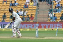 Indian batsman Abhinav Mukund looks back as he is clean bowled by Australian bowler Josh Hazlewood on the third day of the second Test match between India and Australia at The M. Chinnaswamy Stadium in Bangalore on March 6, 2017. / AFP PHOTO / Manjunath KIRAN / ----IMAGE RESTRICTED TO EDITORIAL USE - STRICTLY NO COMMERCIAL USE----- / GETTYOUT