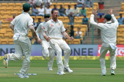 Australian bowler Josh Hazlewood (C) celebrates the dismissal of Indian batsman Abhinav Mukund with his team mates on the third day of the second Test match between India and Australia at The M. Chinnaswamy Stadium in Bangalore on March 6, 2017. / AFP PHOTO / Manjunath KIRAN / ----IMAGE RESTRICTED TO EDITORIAL USE - STRICTLY NO COMMERCIAL USE----- / GETTYOUT