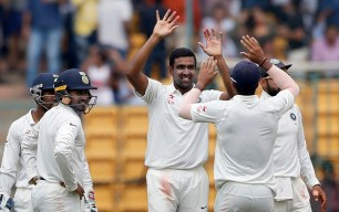 India's Ravichandran Ashwin, facing camera, celebrates the dismissal of Australia's Mitchell Marsh during the fourth day of their second test cricket match in Bangalore, India, Tuesday, March 7, 2017. (AP Photo/Aijaz Rahi)
