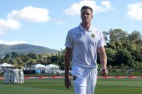 CORRECTION - South Africa's Morne Morkel walks from the field after the national anthems during day one of the 1st International cricket test match between New Zealand and South Africa at the University Oval in Dunedin on March 8, 2017. / AFP PHOTO / Marty MELVILLE / The erroneous mention[s] appearing in the metadata of this photo by Marty MELVILLE has been modified in AFP systems in the following manner: [March 8] instead of [March 7]. Please immediately remove the erroneous mention[s] from all your online services and delete it (them) from your servers. If you have been authorized by AFP to distribute it (them) to third parties, please ensure that the same actions are carried out by them. Failure to promptly comply with these instructions will entail liability on your part for any continued or post notification usage. Therefore we thank you very much for all your attention and prompt action. We are sorry for the inconvenience this notification may cause and remain at your disposal for any further information you may require. (Photo credit should read MARTY MELVILLE/AFP/Getty Images)