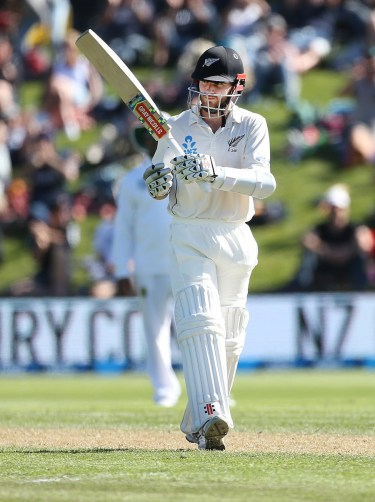 DUNEDIN, NEW ZEALAND - MARCH 09: Kane Williamson of New Zealand celebrates his 50 during day two of the First Test match between New Zealand and South Africa at University Oval on March 9, 2017 in Dunedin, New Zealand. (Photo by Dianne Manson/Getty Images)