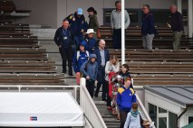 Members of the public are evacuated from the main stand after a fire alarm during day three of the first international cricket test match between New Zealand and South Africa at the University Oval in Dunedin on March 10, 2017. / AFP PHOTO / Marty MELVILLE