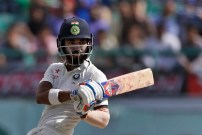India's Lokesh Rahul plays a shot during the fourth day of their fourth test cricket match against Australia in Dharmsala, India, Tuesday, March 28, 2017. (AP Photo/Tsering Topgyal)