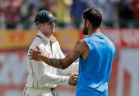 Australia's captain Steven Smith, left, and India's captain Virat Kohli shake hands after India won their fourth test cricket match against Australia in Dharmsala, India, Tuesday, March 28, 2017. India won the Border-Gavaskar trophy and the series. (AP Photo/Tsering Topgyal)