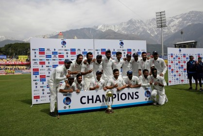 Indian team poses with the Border-Gavaskar Trophy after winning the test cricket series against Australia in Dharmsala, India, Tuesday, March 28, 2017. India won the four-match series 2-1. (AP Photo/Tsering Topgyal)