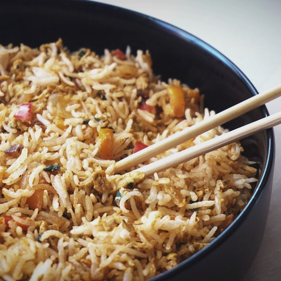 Masala Scrambled Egg Fried Rice in a bowl with chopsticks