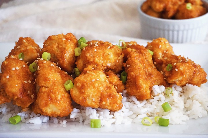 general tso cauliflower and rice on plate