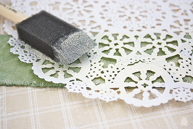 Stenciling (using a paper doily) onto the paint dipped drop cloth soap wraps!