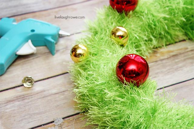 Attaching ornaments to the retro yarn wreath.