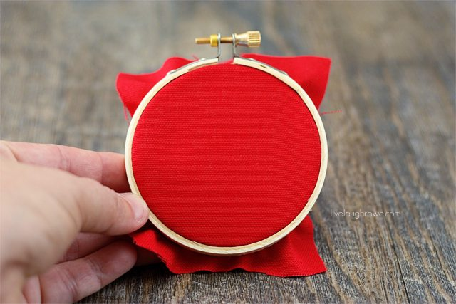 Place fabric in the hoop and trim (or glue to back).