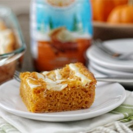 Skinny Pumpkin Cream Cheese Swirl Bars. Served warm, this recipe will have your taste buds doing a happy dance. www.livealaughrowe.com #dessert #pumpkin