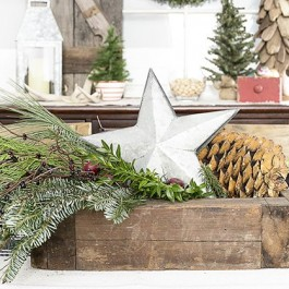 Lovely Christmas centerpiece using a vingtage box, greenery and a galvanized star. livelaughrowe.com