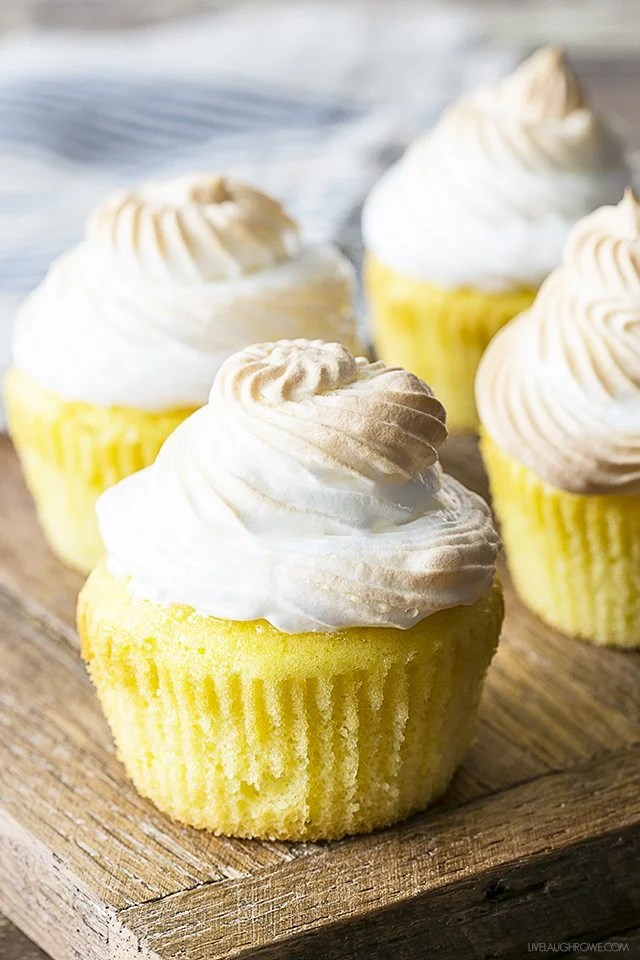 A cheery and delicious treat! These Lemon Meringue Cupcakes have a surprise filling that make it a perfect spin off of the classic Lemon Meringue Pie. livelaughrowe.com