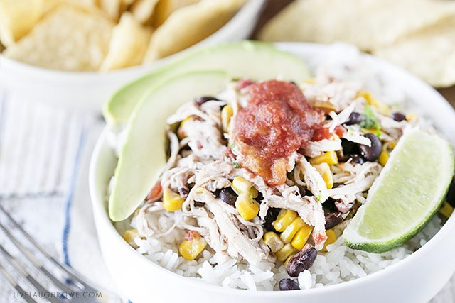 Simple Chicken Burrito Bowl made in the slow cooker. Easy and delicious? Yes, please! livelaughrowe.com