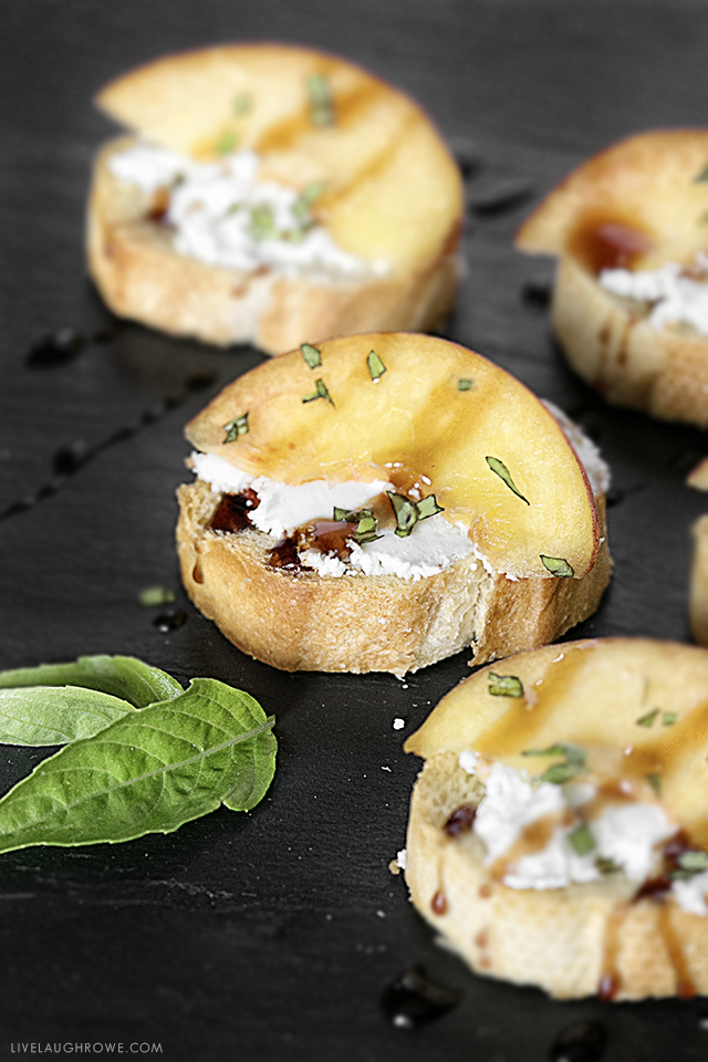 An appetizer that will impress the palates of your friends. Peach Crostini with Goat Cheese and other flavorful ingredients. Simple and delicious! Recipe at livelaughrowe.com