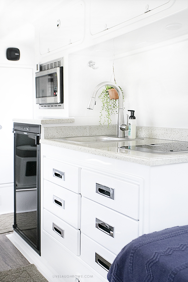 Take a look inside our Oliver Travel Trailer, a high quality fiberglass trailer that we recently purchased! It's built for use in all four seasons as well. This is the kitchenette area. More at livelaughrowe.com