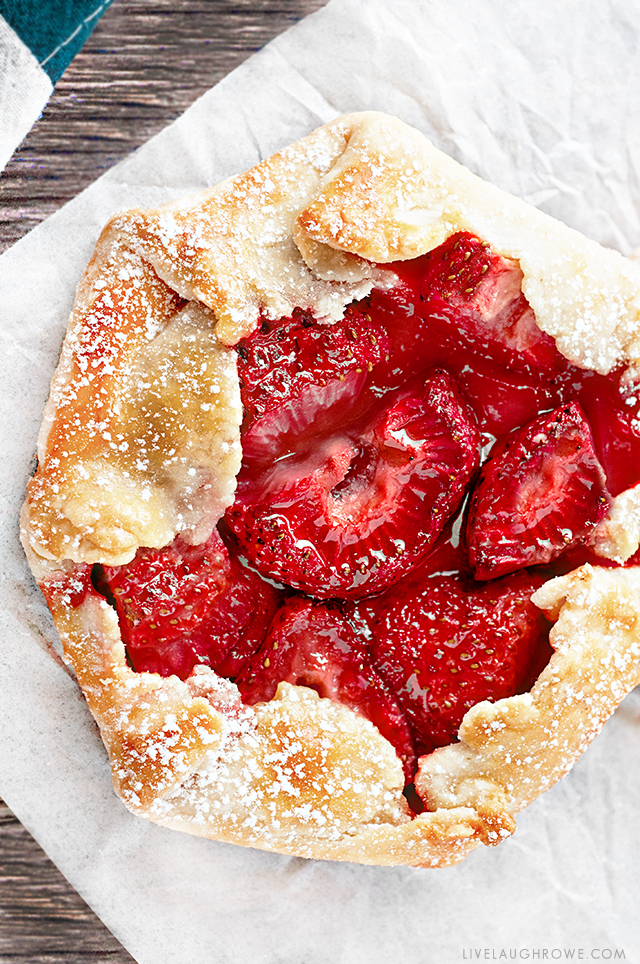 The free form flaky pie crust wrapped around the fruit makes these Mini Strawberry Galettes as easy as pie! A simple rustic, summer dessert . Recipe at livelaughrowe.com