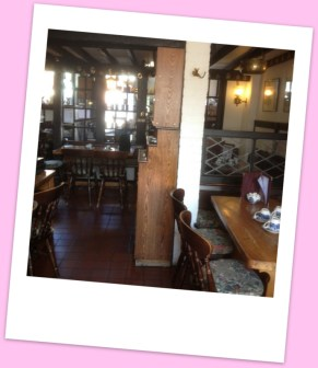 Olde Worlde tearooms with oak furniture & a beamed ceiling